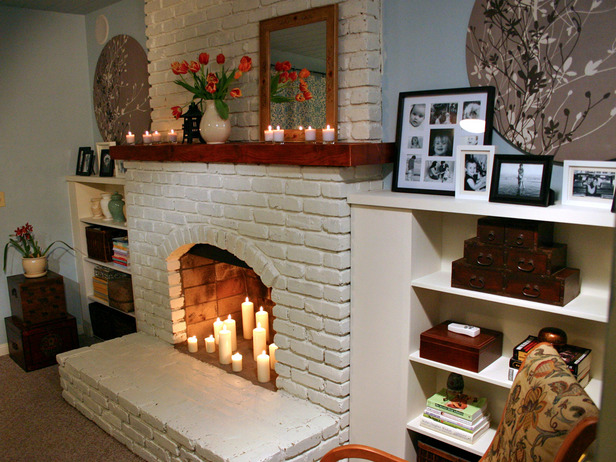 raised hearth, candles, fireplace, white brick